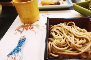 Chilled soba noodles with a cup of dipping sauce in the background. Perfectly chewy, with that earthy, subtle sweetness characteristic of buckwheat. And yes, that is a chopstick rest, not just some random piece of art that happened onto our dinner setting.
