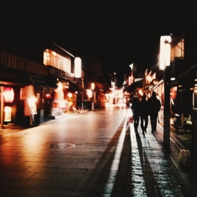 Gion becomes something else entirely at night--the muffled strains of conversation from within teahouses, lanterns setting the streets on fire.